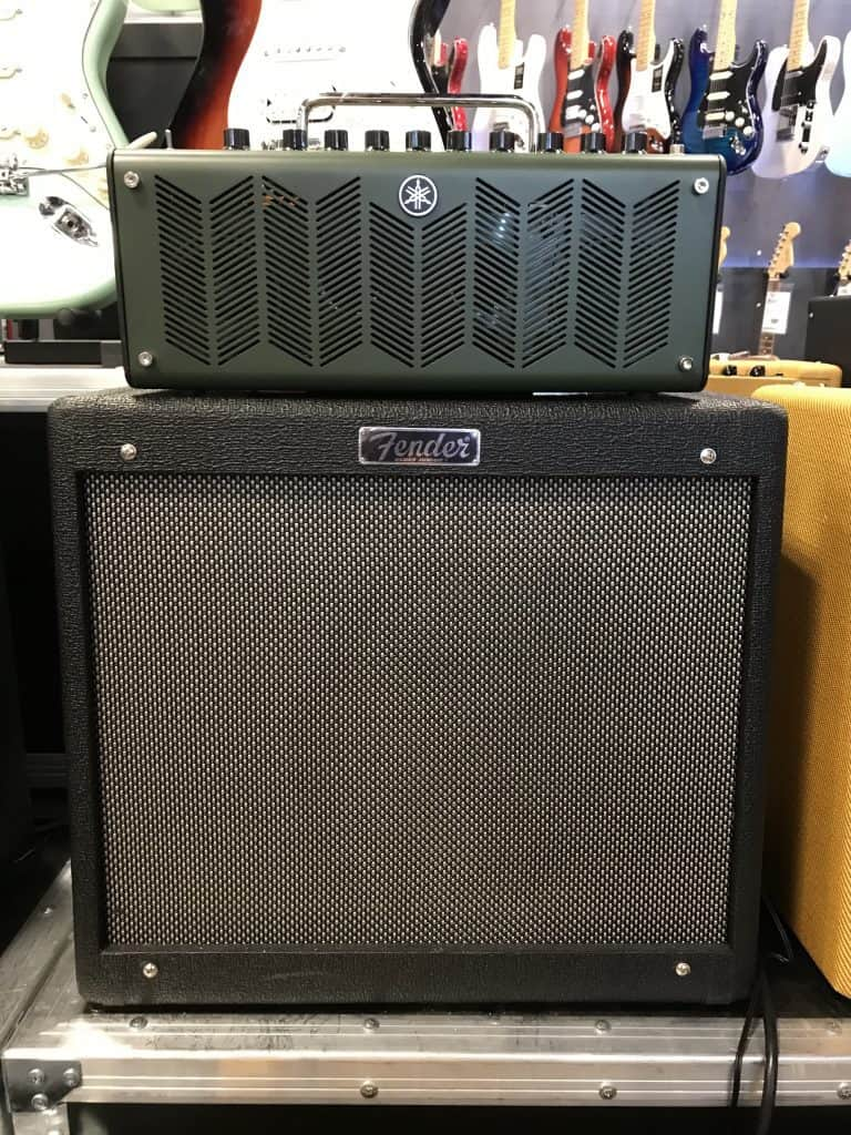 Fender amp Cabinet with a Yamaha head on top of it